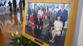 McMaster family in wooden frame at entrance of venue