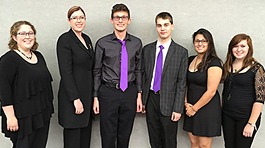 Six members of honors band dressed in black