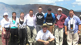 nine students in front of scenic mountain view in Nicaragua