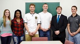 six students in front of chalkboard
