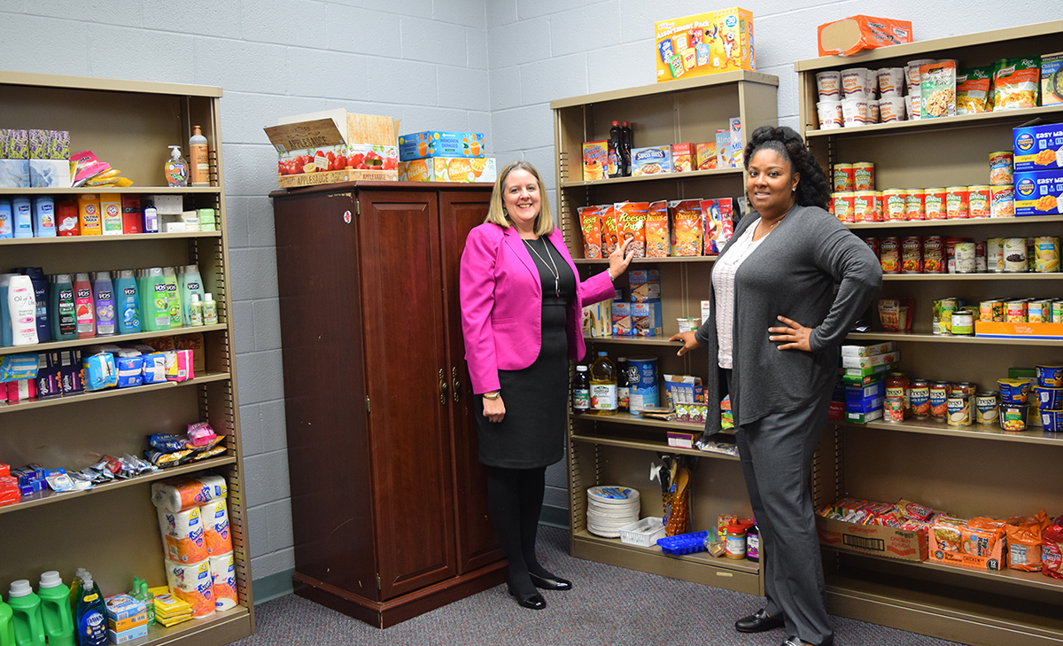 Lisa Marsalek and Mercedes Clay in the Jacket Care corner with shelves of supplies
